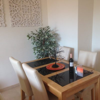 Dining table and chairs in Casares apartment