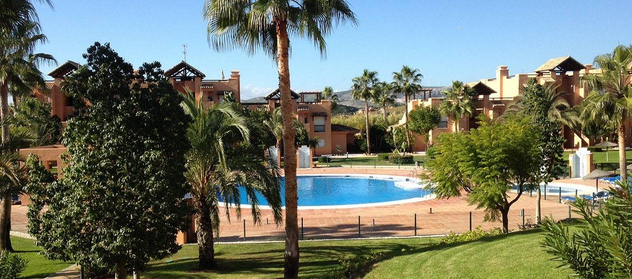 Beautiful gardens surround Casares del Sol apartment