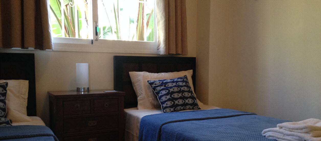Second Bedroom in Casares del Sol apartment with garden views.