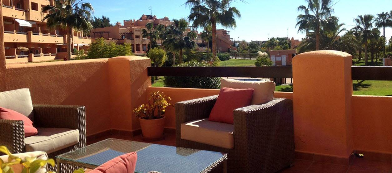 Terrace at Casares del Sol with comfy sofa and chairs for relaxing